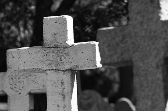Tombstone cross Notre Dame Cemetery Montreal