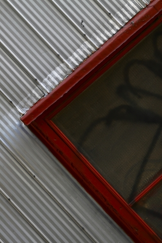 red window frame steel siding
