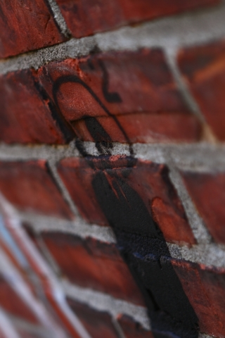 red brick stenciled man